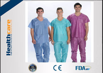 China Soft Nonwoven Disposable Scrub Suits With ISO13485 Surgical Nurse Coat Pink Dark Green supplier